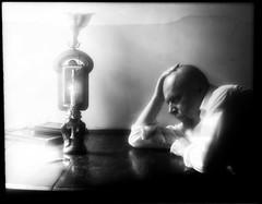 Inhospitable Art: Santa Muerte (Giovanni Savino Photography) Tags: man art table candle burning thinking santamuerte magneticart giovannisavino inhospitableart baldmanatthetable