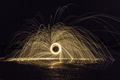 Wheel of fire (Explored 02/09/14) (Yelsel_R) Tags: longexposure nightphotography lighthouse reflection beach water silhouette coast spinning sparks steelwool lesleyrands