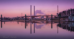 Bolte Reflections (brad.scholes) Tags: bridge sky seascape color colour reflection composition sunrise reflections landscape nikon skies cityscape perspective bridges australia melbourne victoria reflect docklands f22 bolte d80