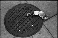 Washington, DC (TheRobbStory) Tags: street 50mm daylight dc washington iso400 voigtlander bessa bra grain dcist kodaktrix manhole 135 r3a selfdeveloped canon5014 hc110b robbhohmann