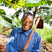 Burundi farmer with hoe and bananas by Isabel Corthier Caritas International Belgium