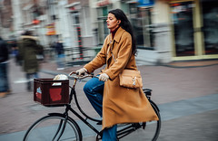 Bell Bottom Tan (Rolling Spoke) Tags: bike bicycle bici bicicleta bicicletta ciclismo fiets fahrrad velo street streetphotography cycling cyclechic vogue chic cycle ride fashion style bellbottoms jacket tan overcoat girl basket amsterdam