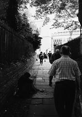Shortcut to the Bearpit (joshuacolephoto) Tags: street streetphotography streetwalk people contrast lines travel explore journey jcm joshuacole nikon f100 ilford xp2 400 135 35mm film bristol peopleofbristol bristolstreetphotography england uk bnw blackandwhite bw noir