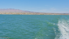 View of Shore from Boat (Mrinmoy Saha) Tags: view shore boat havasu island lake water river pond reflection stream wet flow ocean hill mountain rocky rock blue sky day sun sunny nikon d52000 dslr panaromic tall wide nature landscape manual earth top bright dim shadow light around look travel happy life lively adventure globe world lonely peace peaceful calm quiet moment sharp clear soft beautiful capture red green color colors vivid vibrant legend