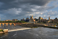 Sunset over the milling district (schwerdf) Tags: bridges cloudscapes goldenhour guthrietheater hdr millingdistrict minneapolis minnesota northstarwoollenmill stanthonyfalls stonearchbridge thunderclouds washburnamill