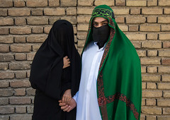 Portrait of iranian shiite muslim couple with their faces hidden by a veil mourning imam hussein on tasua during the chehel manbar ceremony one day before ashura, Lorestan province, Khorramabad, Iran (Eric Lafforgue) Tags: 20s 2people adultsonly ashura celebration ceremony clothing colorimage couple covered face hidden horizontal husband imamhussein iran islam khorramabad lookingatcamera man memorialevent middleeast mourners mourning muharram muslim mystery niqab outdoors people portrait religion religious ritual shia shiism shiite tasua tradition traditional twopeople unrecognizableperson veil waistup wife woman lorestanprovince