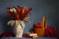 Still life featuring handcrafted pottery vase. (Phyllis Freels) Tags: phyllisfreels protearepens aster basket bluebackground books dustymiller flowers glasses indoor pottery spectacles stilllife tabletop vase