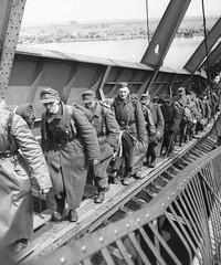 #German soldiers walk across a precarious platform spanning a ruined bridge over the Elbe River to surrender to American forces, rather than the Soviets. 1 May 1945. [1065 x 1279] #history #retro #vintage #dh #HistoryPorn http://ift.tt/2gZlMVJ (Histolines) Tags: histolines history timeline retro vinatage german soldiers walk across precarious platform spanning ruined bridge over elbe river surrender american forces rather than soviets 1 may 1945 1065 x 1279 vintage dh historyporn httpifttt2gzlmvj