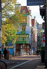 Colorful Buildings along Paleisstraat near the Singel Canal, Amsterdam (PhotosToArtByMike) Tags: paleisstraat singel amsterdam netherlands singelcanal dutch holland shops buildings bikes canalring grachtengordel