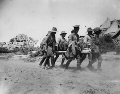 WWI2113GP (ww1images) Tags: station soldier track post path wounded helmet australian tent equipment cap doctor blanket dust medic dugout bearer officer digger pith injured redcross casualty orderly hillock allied puttee strecher greatcoat