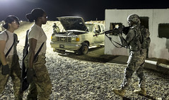 Soldiers from  U.S. Army Central Command Warrior Leadership Course conduct their final training lanes and evaluations with squads of soldiers versus mock opposing forces across multiple lanes during the night of July 10, 2014 in Camp Buehring, Kuwait. (N. (New York National Guard) Tags: urban night training soldier army central course lane warrior stx kuwait combat command leadership m4 m16 ied warfare mout wlc oef operationenduringfreedom m4carbine campbuehring arcent