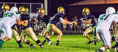 High school football: hand-off (rikki480) Tags: game field ball football play hand stadium quarterback indiana run off highschool southside bishop carrier fortwayne zollner dwenger