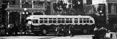 Disneyland bus from LA poses at Disneyland City Hall, 1956 (Tom Simpson) Tags: bus vintage metro cityhall disneyland disney 1956 vintagedisneyland vintagedisney
