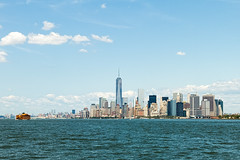 Isle of Manhattan (ChristopherCamp) Tags: sky building water ferry skyline clouds island boat state manhattan line empire empirestatebuilding staten freedomtower