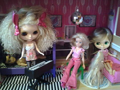 Miss Kenner and Sindy have come upstairs to hear Paige play her new keyboards.