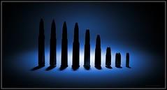 Family (J Michael Hamon) Tags: bullet bullets ammo ammunition cartridge firearm firearms weapon brass hamon nikon d3200 nikkor 35mm vignette photoborder blue light lighting shadow stilllife tabletop