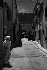 Nmes / Aiguesmortes (Kalank) Tags: granny grandmre babouchka silhouette walking marche blackwhite old ladie senior rue street aiguesmortes sud france