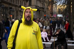 Peekatyou (Leanne Boulton) Tags: people urban street photography streetphotography candidstreetphotography streetlife streetportrait portrait portraiture impromptu man male face facial hair beard expression eyes look emotion feeling eyecontact candideyecontact costume cosplay pokemon pikachu yellow onesie bright colourful colorful excited happy happiness fun funny humour humorous tone texture detail depthoffield bokeh natural outdoor light shade shadow city scene human life living humanity society culture canon 7d 50mm color colour glasgow character scotland uk
