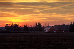 dawn on the farm (Christian Collins) Tags: ef70200mmf4lusm canon t2i sunrise farm barn red field dirt squiggly amanacer granjero campo east vibrant orange early