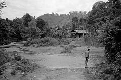 Passing river (pacco_racco) Tags: river village boy house middlemekong northernlaos leicam6 leicasummicron35mmf20asph kodaktrix400