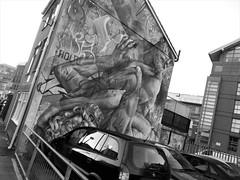 fight over a parking lot (vfrgk) Tags: parking car city artwork graffiti paint buildingdetail reflections urbanphotography urbanfragment urbanart urbanmoment cityscape bw monochrome blackandwhite streetart fight fighting urbanbeauty