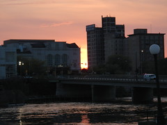 Downtown South Bend (tquist24) Tags: city sunset urban sun river geotagged evening downtown indiana southbend stjosephriver nikoncoolpixaw100