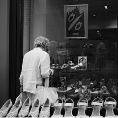 On sale. (Pottpourri) Tags: street grandma white black window shoes sale streetphotography gr ricoh percentage