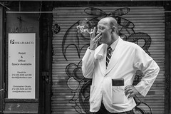 Okada & Co. (Gisele Duprez) Tags: nyc blackandwhite candid streetphotography smoking smoker littleitaly