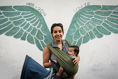 Motherhood gives me wings (Flavio~) Tags: street portrait woman baby green beauty sunglasses wall angel portraits wings young mother jaffa graffitti photogroup surprize