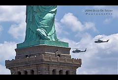 At the feet of Liberty (Far & Away (On assigment, mostly off)) Tags: nyc rescue usa newyork france feet statue lady clouds america liberty island foot freedom chains apache cobra god roman sandals space military air flight progress gear security icon aerial helicopter gift mission independence protection slavery iconic liberation copter homeland armed opression libertas