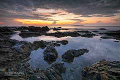 Sunrise at Pantai Pandak (Nur Ismail Photography) Tags: reflection sunrise rocks fujifilm rockybeach terengganu kualaterengganu xt1 chendering pantaipandak nurismailphotography nurismailmohammed nurismail visitmalaysiayear2014