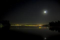 Lights of the stars, moon and city (jasu_2009) Tags: city longexposure moon water night canon stars eos lights 1100d