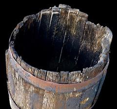 Oil Barrel (rustyruth1959) Tags: nikon nikond3200 tamron16300mm germany germanoilmuseum deutscheserdölmuseum wietze oil museum outdoor barrel oilbarrel wood decay rust blackbackground staves rings hoops container hollow