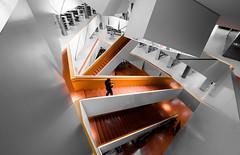 Stairs in orange color II (rainerralph) Tags: architecture objektivmzuikodigital714pro bavaria architektur augsburg bayern omdem5markii olympus stair library bibliothek orange treppe staircase