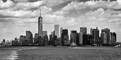 Lowertown Skyline (Ben_Senior) Tags: newyorkcity newyork newyorkstate ny nyc us usa unitedstates unitedstatesofamerica america clouds city downtown lowermanhattan lowertown manhattan bensenior ferry nikond7100 nikon d7100 buildings building tower skyline sky bnw blackandwhite helicopter freedomtower wtc wtc1 water upperbay