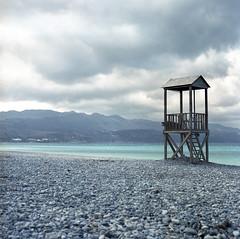Nobody to save (Jeszyna) Tags: greece crete rapaniana beach pebbles baywatch deserted aegeansea clouds