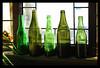 Green Bottles. (Poocher7) Tags: green shades shadesofgreen olivegreen aloevera aloe plant windowlight windowsill light shadows oldbottles greenbottles dirtywindow leadedglass oldwindow antique lovely pretty beautiful homey pleasant indoor
