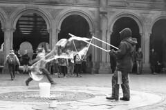 The Bubbler (denver guy) Tags: nyc bubbles bubble centralpark entertainer bw mono film 35mm ilford delta pentax