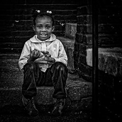 "Happy And Enjoying The Taste Of A Donut, ""Human Warmth Is The Vital Element For The Soul Of The Child"", Martin Luther King Jr. Avenue, Historic Anacostia, Washington, DC (Gerald L. Campbell) Tags: streetphotography street squareformat spirituality spiritualindifference socialdocumentary bw blackwhite citylife community digital dc washingtondc historicanacostia kids love martinlutherkingjravenue portrait portraitphotography textures urbanphotography urban youth yearning yeswecan canonsx60hs"