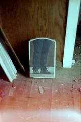 Aside (benjaflynn) Tags: minolta x370 minoltax370 slr singlelensreflex minoltamd50mmf17lens 50mmfocallength primelens pancakelens fixedfocallength soft manualfocus 135format 35mmfilm analog antique retro vintage fujifilmpro160s fujipro160s expiredfilm expired112009 iso160 filmgrain grainy scanned epsonperfectionv500 benseidelman abandoned abandonedhouse bigrock illinois decay rural weathered dirty mirror lookingdown legs reflection selfie selfportrait me myself tile peelingtile debris trash woodgrain indoors countryhouse rurality creepy bathroommirror feet shoes dark