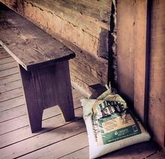 Simplicity (TuthFaree) Tags: elements cabin log chink handmade foxfire porch floor ga georgia antique bench hbm benchmonday light shadow simple plain