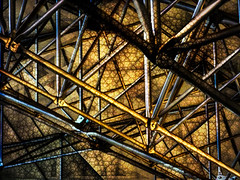 Webs Within Webs Within Webs (Steve Taylor (Photography)) Tags: web joints bolted struts gold art abstract digital architecture building roof black blue brown metal newzealand nz southisland canterbury christchurch lines texture