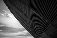 Velodrome 3 (marktmcn) Tags: underneath undercroft olympic velodrome the pringle london lee valley velopark queen elizabeth park wood paneling sky clouds shaded sweeping curves blackandwhite monochrome d610 nikkor