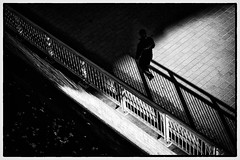 The Spy Who Escapes Into The Darkness (Armin Fuchs) Tags: arminfuchs diagonal light shadow person agent spy darkness street würzburg mainkai