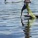Burmese fisherman rowing with the leg, Inle lake, Shan State, Burma