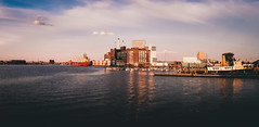 Domino Pano (seikoesquepayne) Tags: light urban panorama film water boats harbor haze natural olympus baltimore sugar inner faux domino f18 stitched ep3 17mm