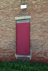 Entrance, Dunlap School — Union Township, Ross County, Ohio (Pythaglio) Tags: county door school ohio red building brick abandoned grass stone ross union entrance plate historic doorway vacant bond date schoolhouse common boarded township dunlap 1878 sills oneroom lintels