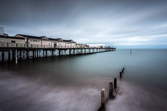 Grand Pier, Teignmouth (Davoud D.) Tags: uk longexposure sea beach water pier waves cloudy piers devon waterblur grandpier teignmouth teignmouthpier