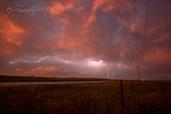 Triple Treat (shannbil (Signature Exposures)) Tags: sunset canada storm nature beauty field clouds landscape rainbow power ominous stormy lightning prairie cloudscape stormchasing prairiestorm signatureexposures skstorm shannonbileski shannbil