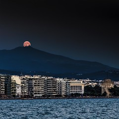 Thessaloniki's Moon besides The White Tower (Nick Papakyriazis) Tags: sea summer mountain port boat fullmoon macedonia thessaloniki timeless whitetower appreciated